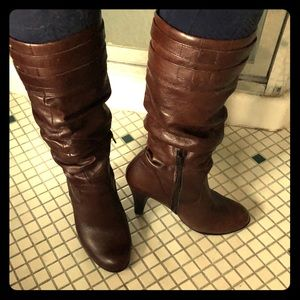 Tall brown heeled boots